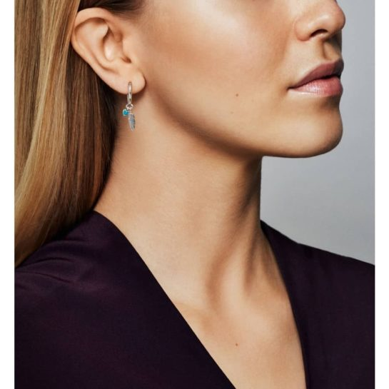 Model wearing Pandora Spiritual Feathers Earrings