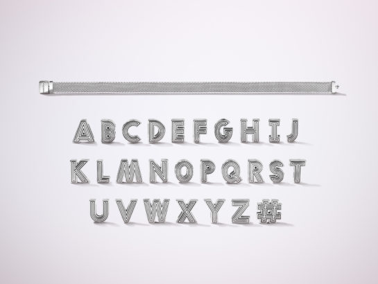 Pandora Reflexions silver bracelet with every alphabet charm arrange in rows below.