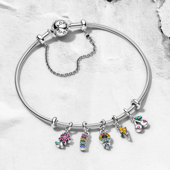 Pandora Me silver bangle with flower, rainbow, venus, lightning and cherry charms