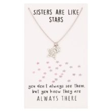 "Silver necklace with two engraved star shapes, and card packaging stating ""sisters are like stars"""
