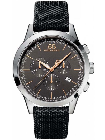 a silver watch with a black dial and chronograph display and black fabric straps.