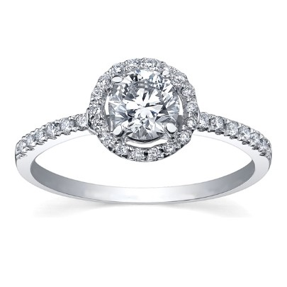 white gold diamond halo ring with diamond-set shoulders