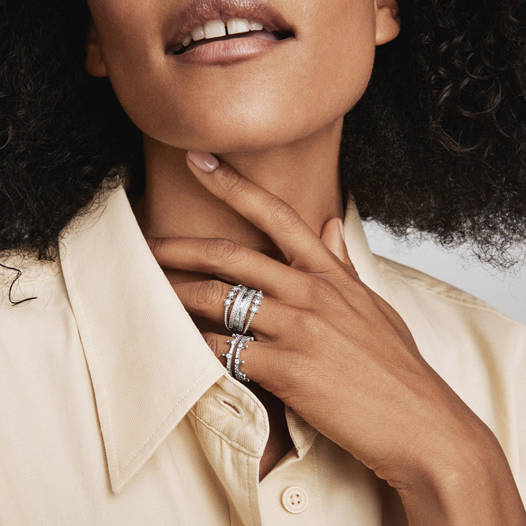 woman with multiple ring stacks on fingers